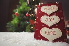 与和平、喜悦和希望按摩的圣诞节标签  免版税库存照片
