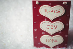 与和平、喜悦和希望按摩的圣诞节标签  库存照片