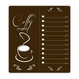 与咖啡杯的咖啡卡片在棕色背景 库存照片