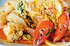 与咖喱粉的油煎的螃蟹。 库存图片
