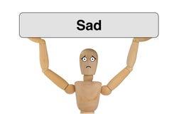与哀伤的面孔的木偶 免版税库存照片