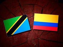 与哥伦比亚的旗子的坦桑尼亚的旗子在被隔绝的树桩 向量例证