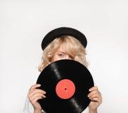 与唱片的妇女闭合值的面孔 免版税库存照片
