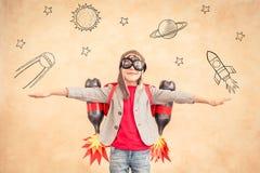 与喷气机组装的孩子在家 免版税库存照片
