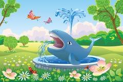 与喷泉鲸鱼的美好的风景 免版税图库摄影