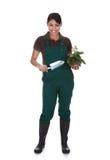 与园艺工具的年轻女性gardner 库存图片