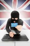 与国旗的网络犯罪概念在背景-英国 免版税库存图片