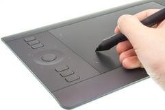 与图形输入板设备一起使用 免版税图库摄影