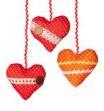 与圆点丝带按钮的三手工制造心脏 免版税库存照片