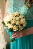 与圆环的婚姻的新娘花束 库存图片