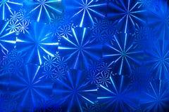 与圆的段的抽象样式背景与在蓝色全息照相的纸的光芒 库存照片