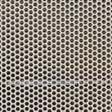 与圈子穿孔的孔的白色钢金属 图库摄影