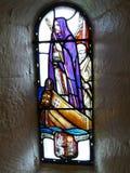 与圣徒天鸽座的玻璃窗 免版税库存图片