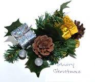 与圣诞快乐笔记的圣诞节叶子 库存图片
