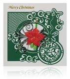 与圣诞快乐问候和poins的手工制造圣诞卡 图库摄影