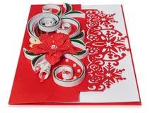 与圣诞快乐问候和poins的手工制造圣诞卡 免版税库存照片