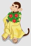 与圣诞树和圣诞节球的猴子 免版税库存图片