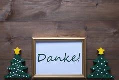 与圣诞树的框架和Danke手段感谢您 免版税库存照片