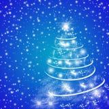 与圣诞树的蓝色寒假贺卡 免版税库存图片