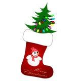 与圣诞树的逗人喜爱的圣诞节袜子 免版税库存照片