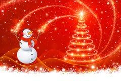 与圣诞树的雪人 免版税库存照片