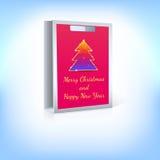 与圣诞树的购物袋 免版税库存照片