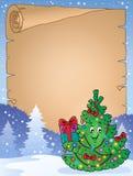 与圣诞树题目1的羊皮纸 库存图片