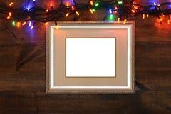 与圣诞灯的古色古香的框架 库存图片