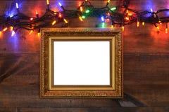 与圣诞灯的金框架 图库摄影