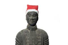 与圣诞老人帽子的中国赤土陶器战士雕象 图库摄影