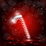 与圣诞老人帽子的圣诞节糖果 库存照片