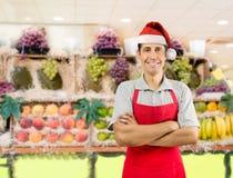 与圣诞老人帽子的店员 库存照片