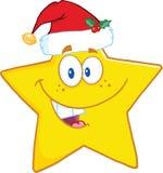 与圣诞老人帽子的微笑的星漫画人物 库存照片