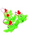 与圣诞老人帽子的青蛙 免版税库存照片