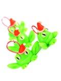 与圣诞老人帽子的青蛙 免版税库存图片