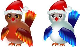 与圣诞老人的帽子的两只鸟 图库摄影