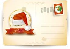 与圣诞老人的帽子的圣诞节明信片 免版税库存图片