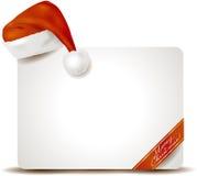 与圣诞老人的帽子的圣诞节盘区 免版税库存照片