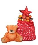 与圣诞老人袋子的圣诞节构成和玩具熊戏弄 免版税库存照片