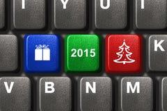 与圣诞节关键字的计算机键盘 库存照片