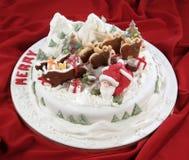 与圣诞节场面的蛋糕 免版税库存照片