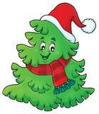 与圣诞节帽子题材1的树 免版税库存照片