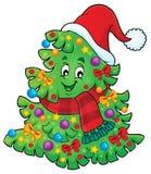 与圣诞节帽子题材2的树 免版税库存照片