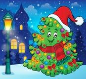 与圣诞节帽子题材3的树 免版税库存照片