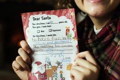 与圣诞节愿望的孩子 免版税图库摄影