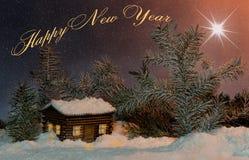 与圣诞节星的卡片在房子和冷杉与题字新年好 库存图片