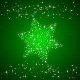 与圣诞节星的绿色背景 免版税图库摄影