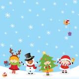 与圣诞节服装的孩子 免版税库存照片