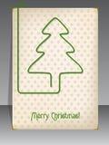 与圣诞节树型纸夹的圣诞卡 库存图片