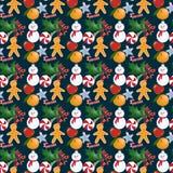 与圣诞节玩具和甜点的无缝的样式 图库摄影